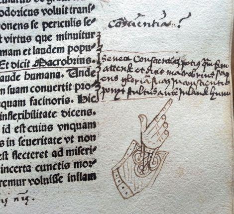 """Glosas marginales de diversas manos y épocas. """"Mano señalando"""": forma muy especial de señalar textos de interés."""